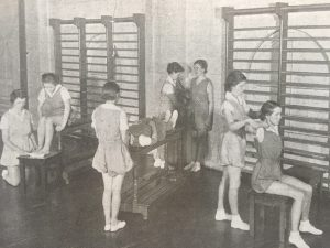 physical therapy students in a clinic in the 1940's. Black and white photo.