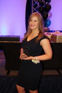 OPA Student Award winner Chelsea Elvy, holding her award at the conference