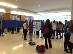 A photo of Research Day, people milling about poesters in Stone Lobby