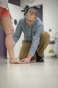 Dr. Karl Zabjek using motion sensors on a patient's leg